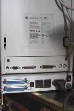 The rear of the Macintosh Plus; you can see all of the perepheral inputs and outputs, and there's even one for the modem; under the Plus is the hard drive with its SCSI ports